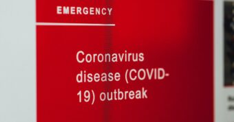 red sign about coronavirus disease outbreak