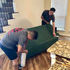 wrapping sofa in moving blankets and stretch wrap