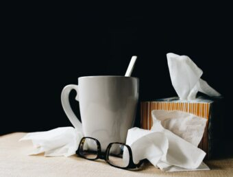 tea cup, tissues, glasses on table