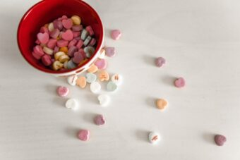 Sweetheart candy's in a bowl.